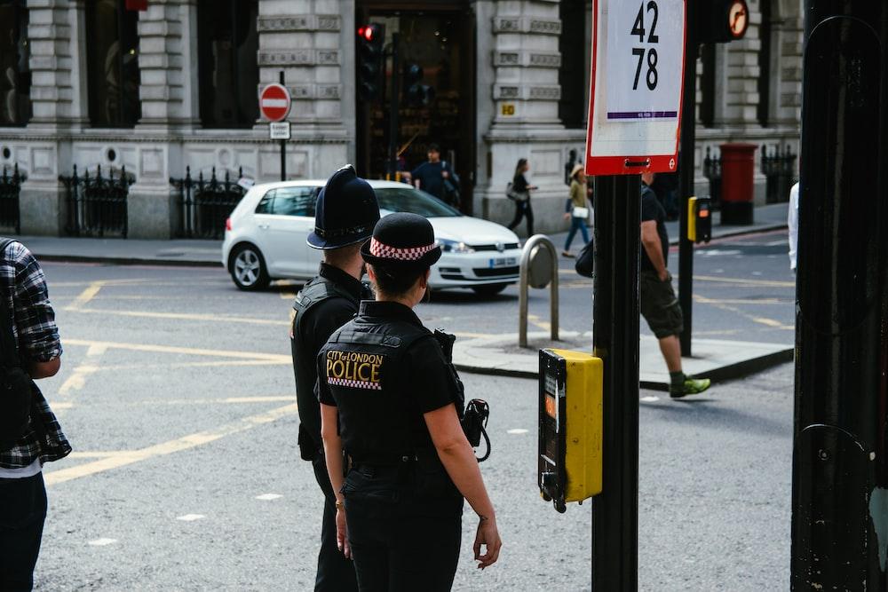woman wearing black police suit