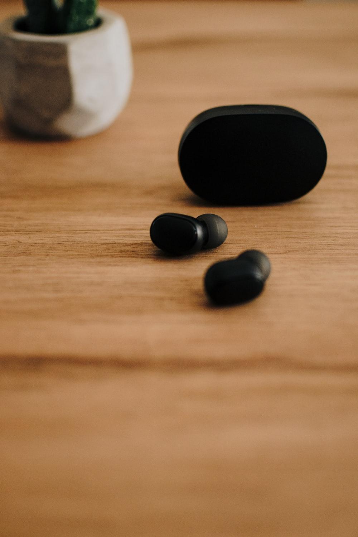 pair of black wireless canalbuds