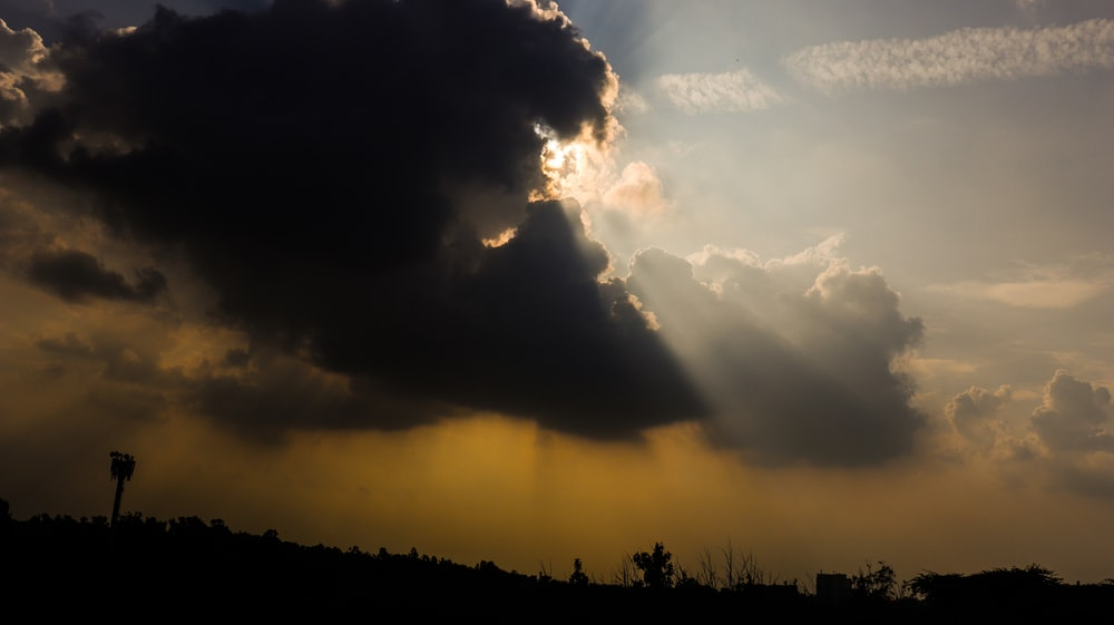 black clouds with sun rays