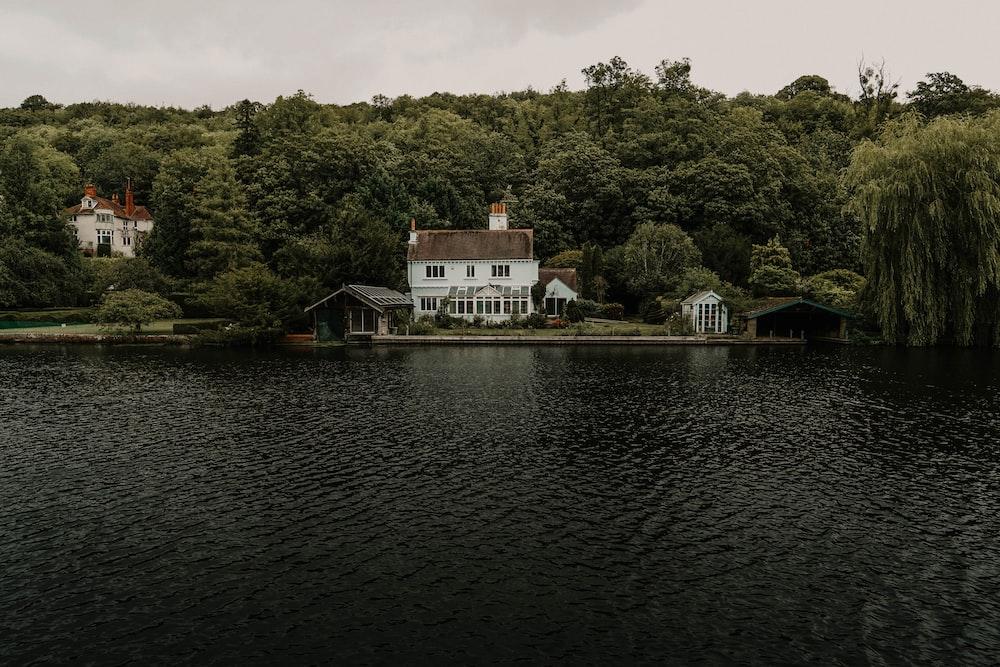 white house near water