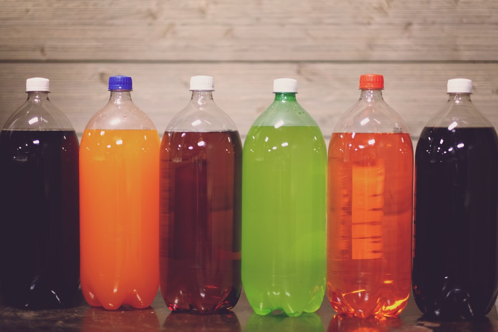 six plastic bottles with assorted-color liquid