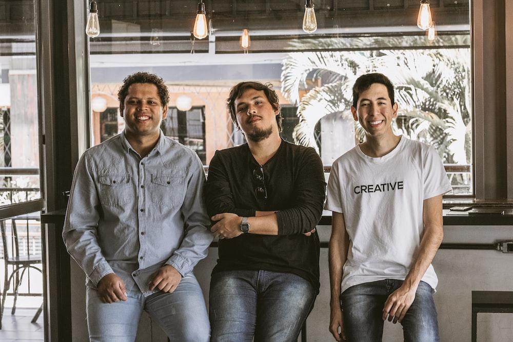 three sitting men near door