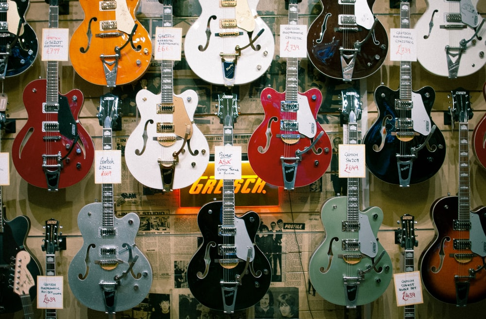 assorted-colored Jazz guitars decors