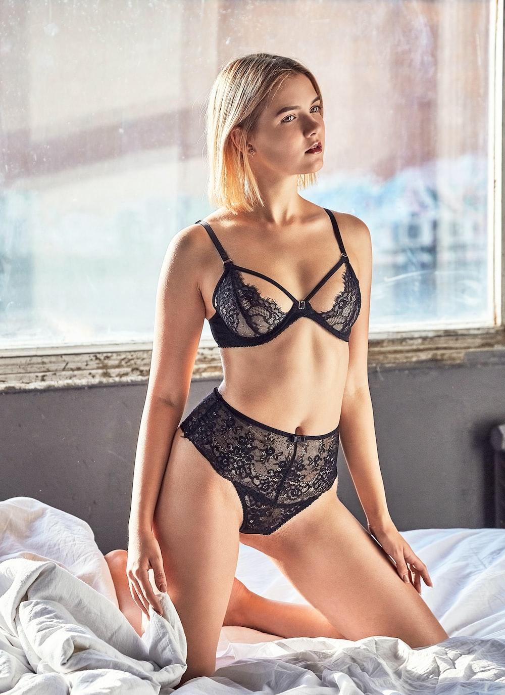 woman kneeling on bed