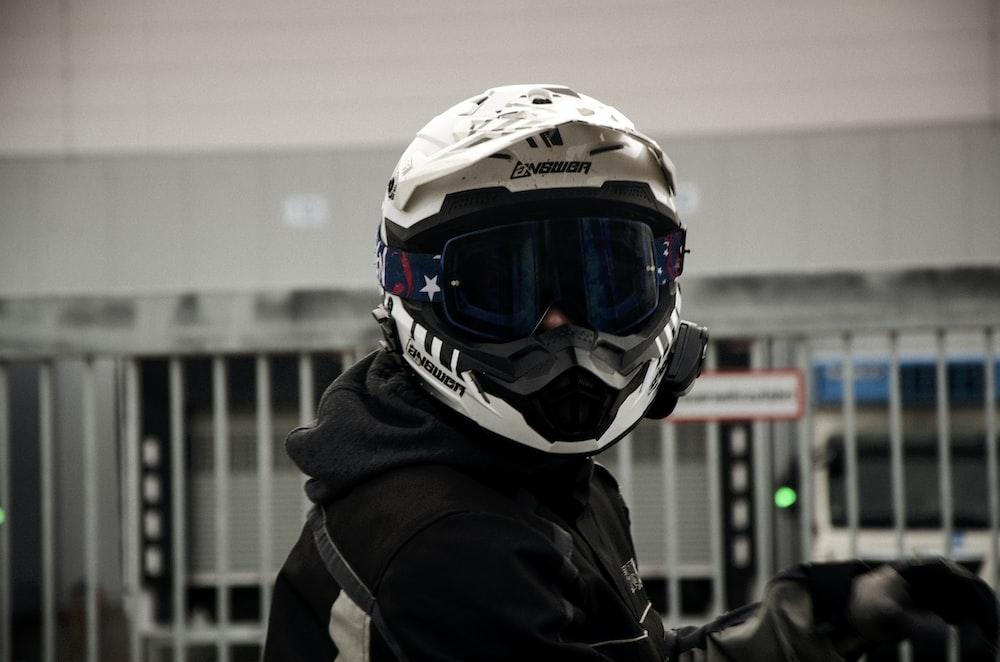 man wearing white and black full-face helmet during daytime