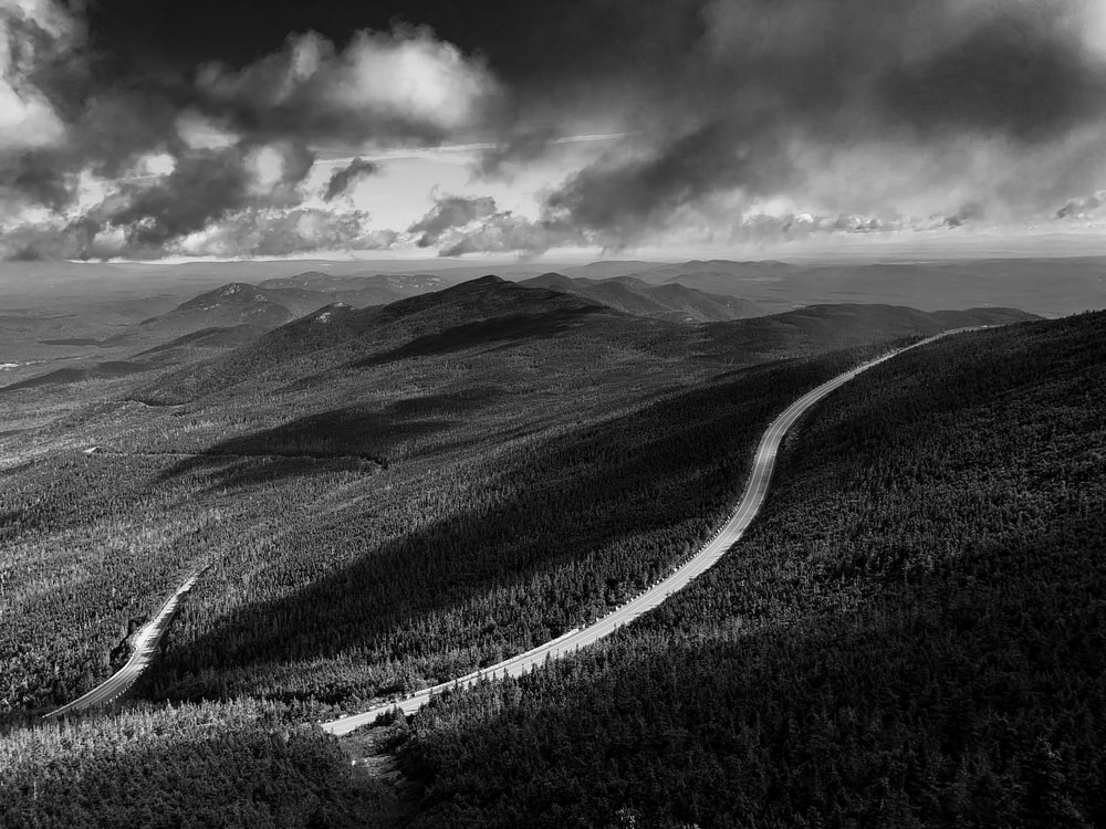 grayscale aerial photography of a road in the land