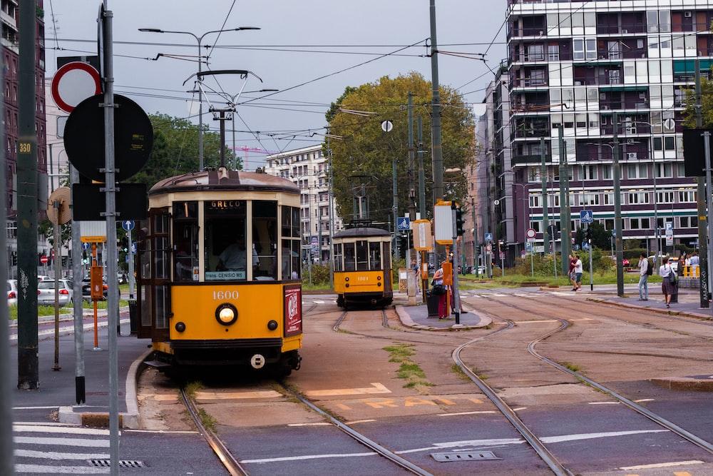 yellow and black city tram