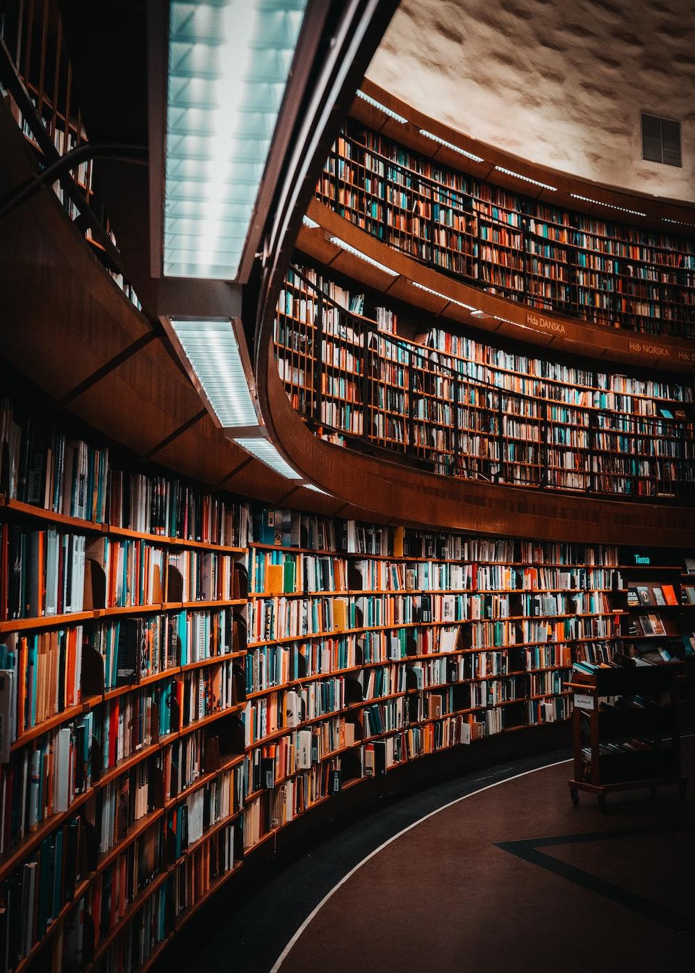 photo of brown wooden bookshelf