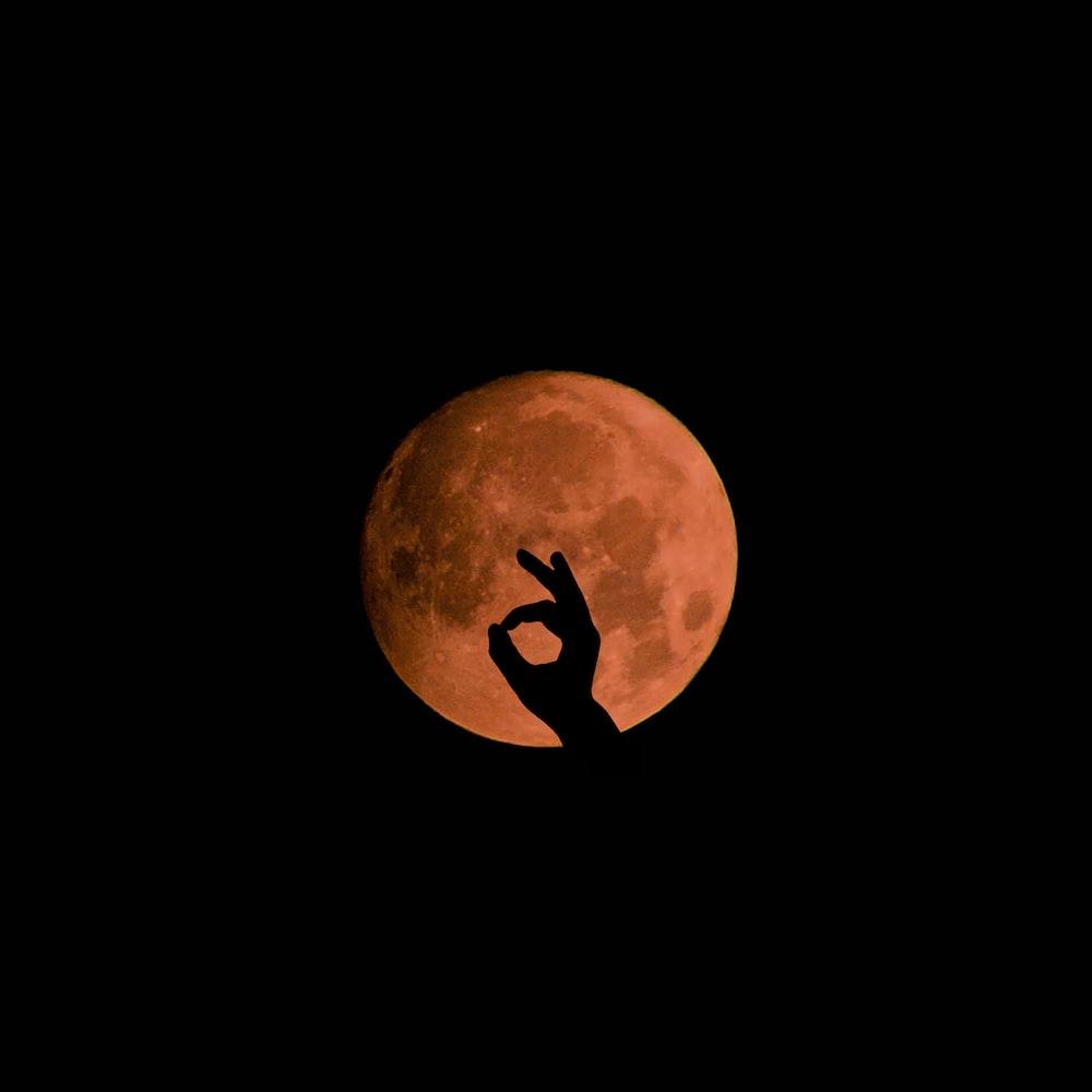 okay hand sign on moon