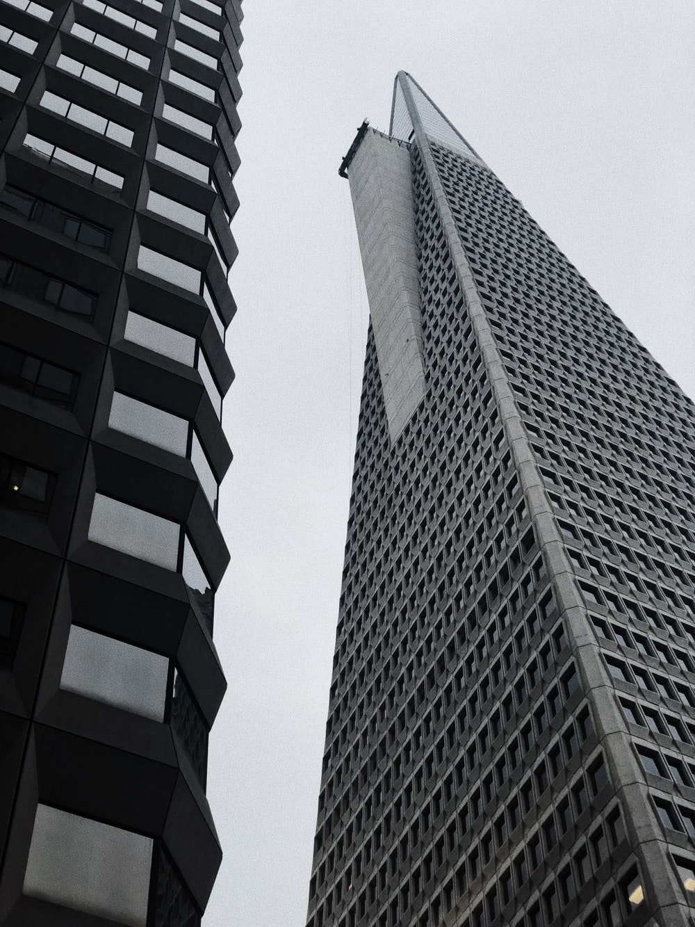 grey curtain buildings during daytime
