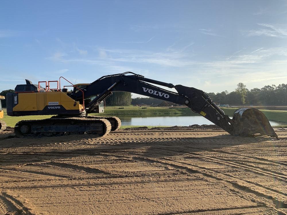 yellow and black Volvo excavator