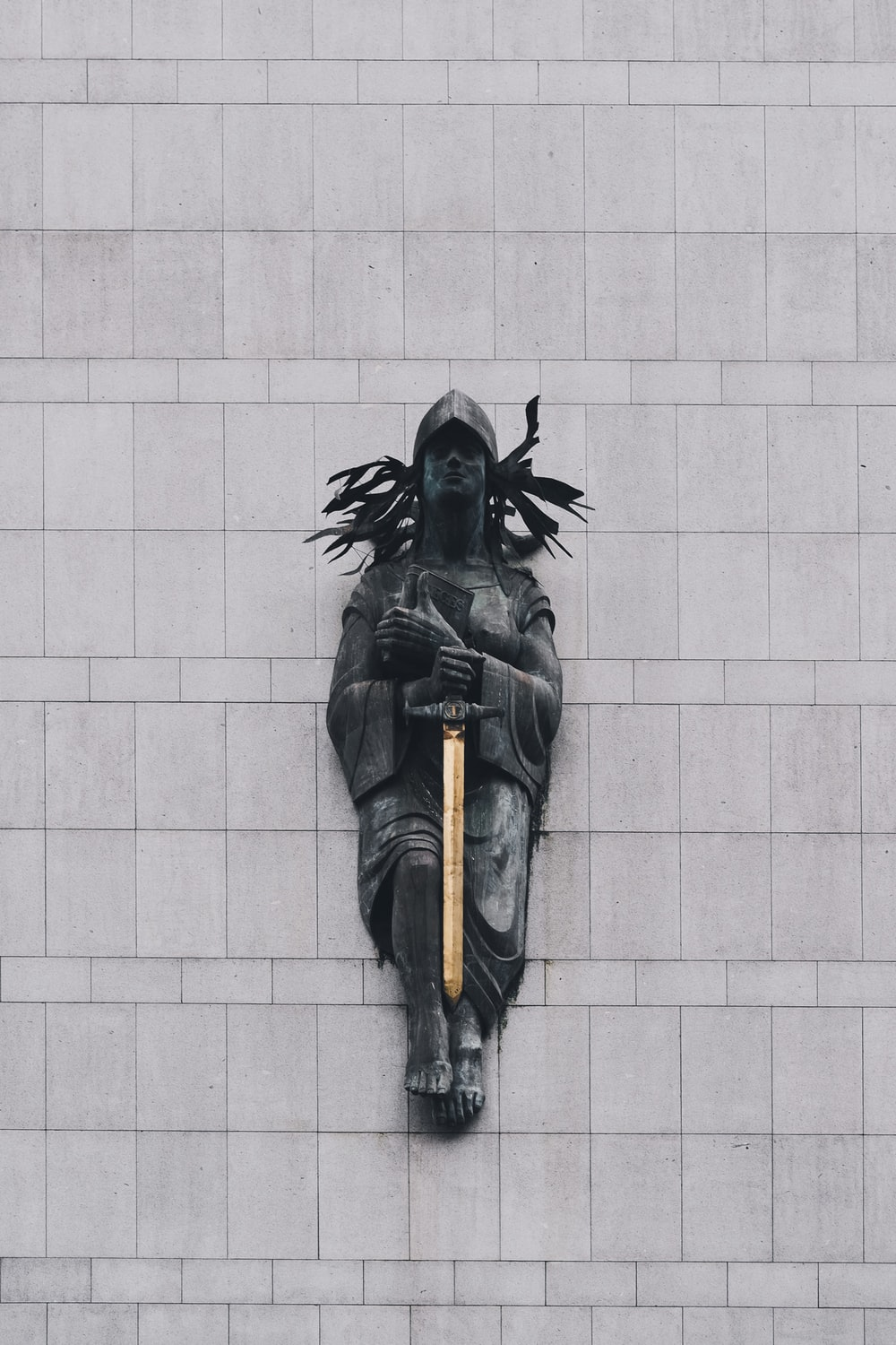 person with sword statue