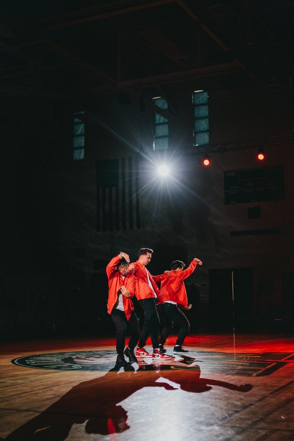 men dancing on stage