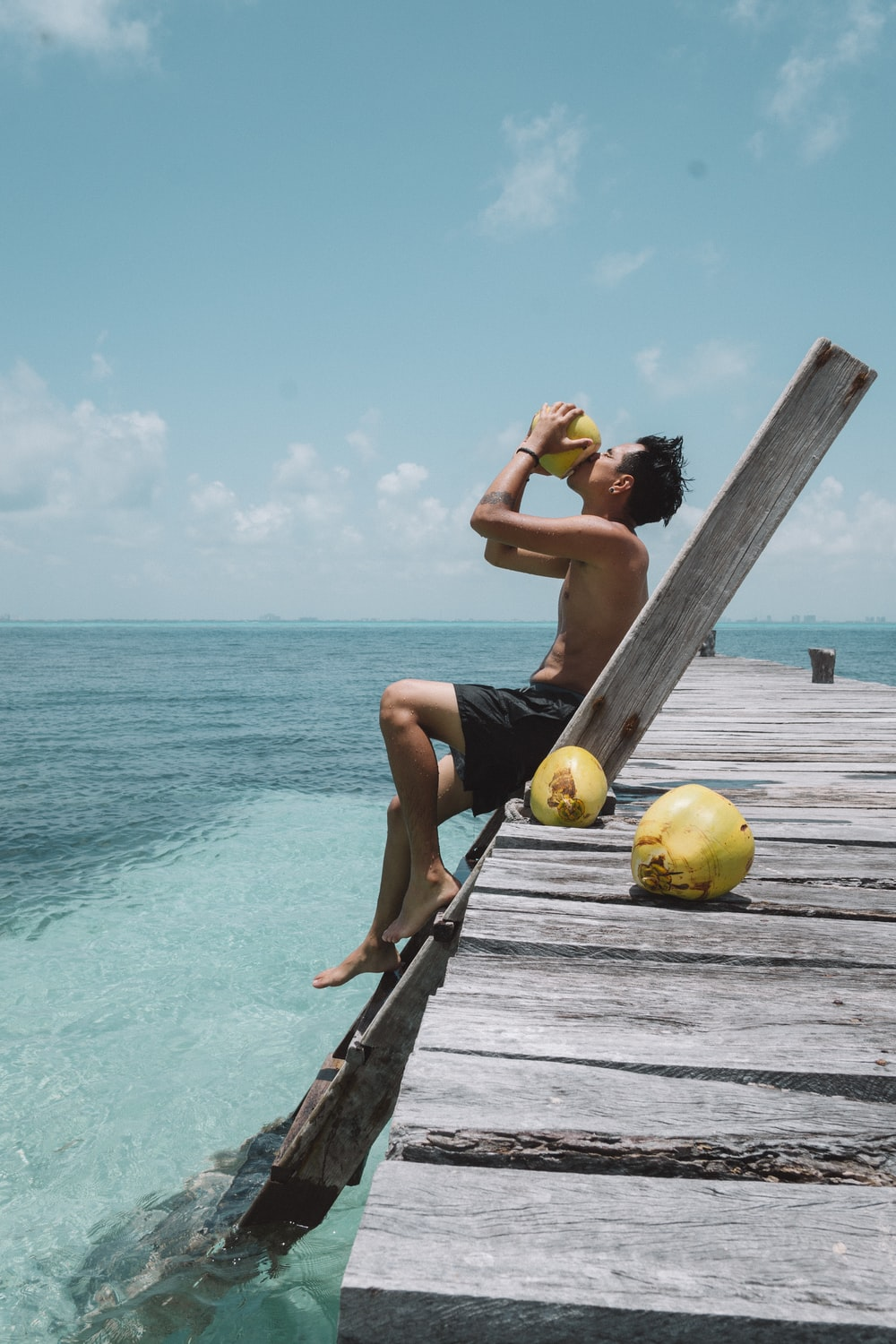person drinking coconut fruit