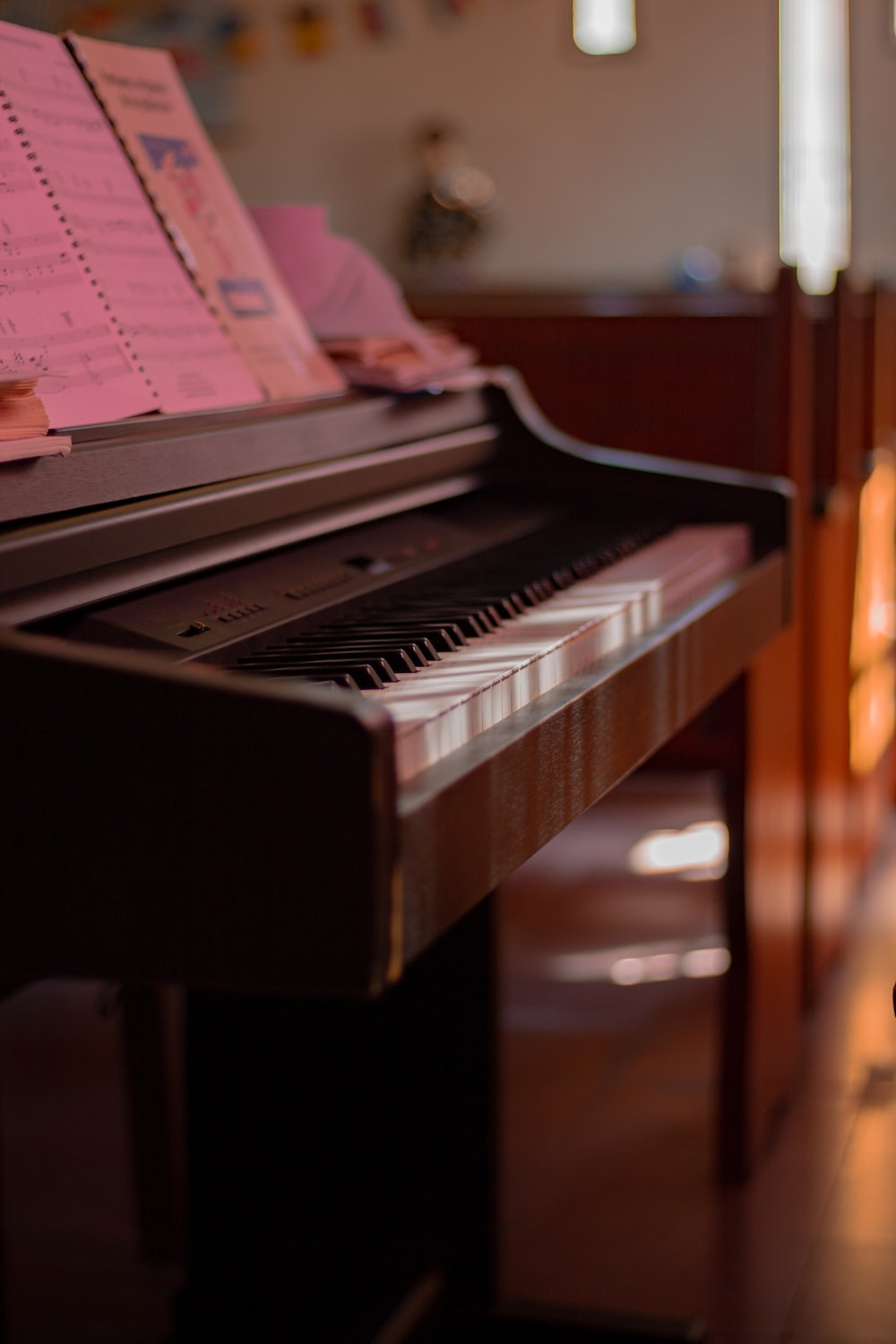 brown spinet piano