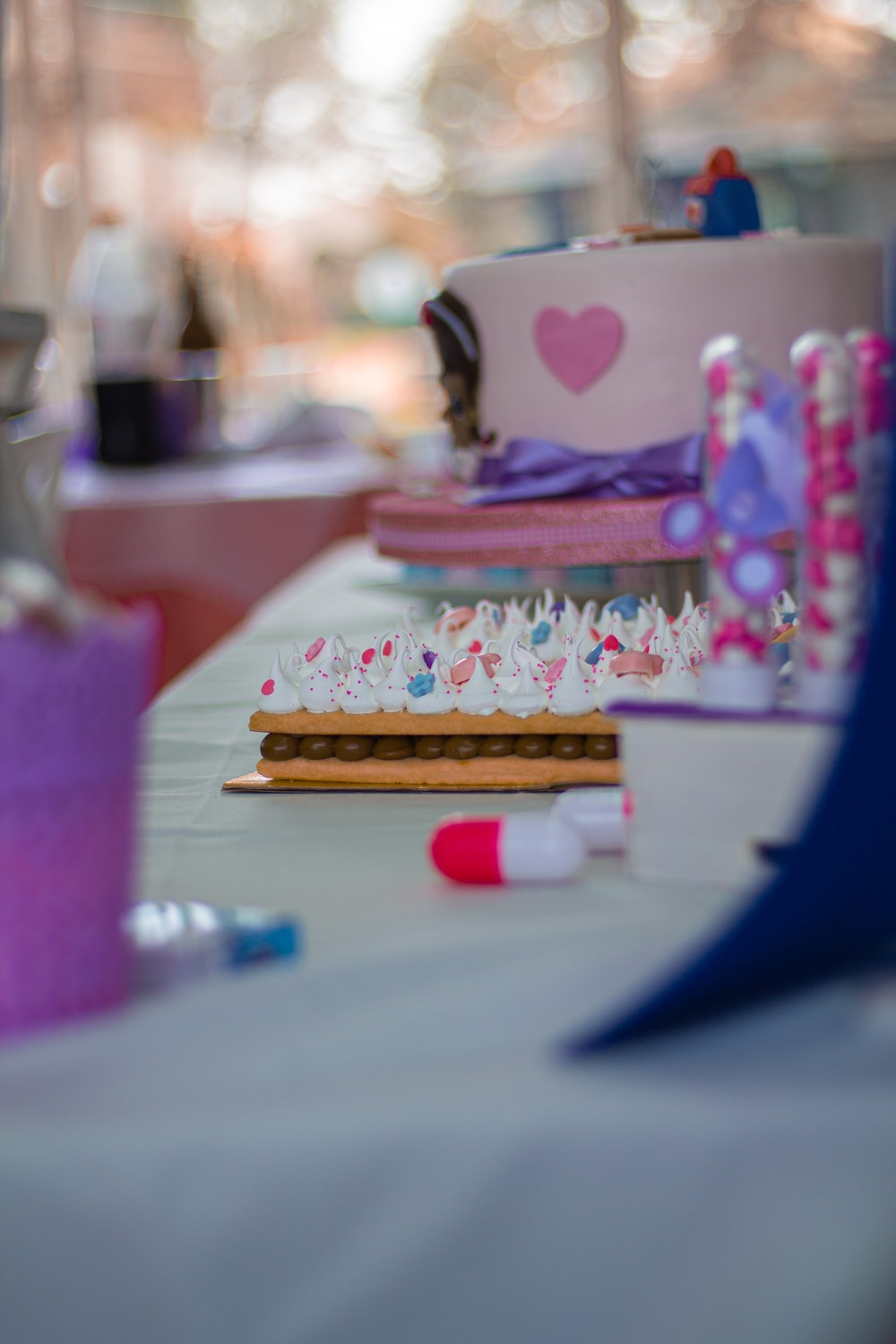 selective focus photography of cake and desserts on white table
