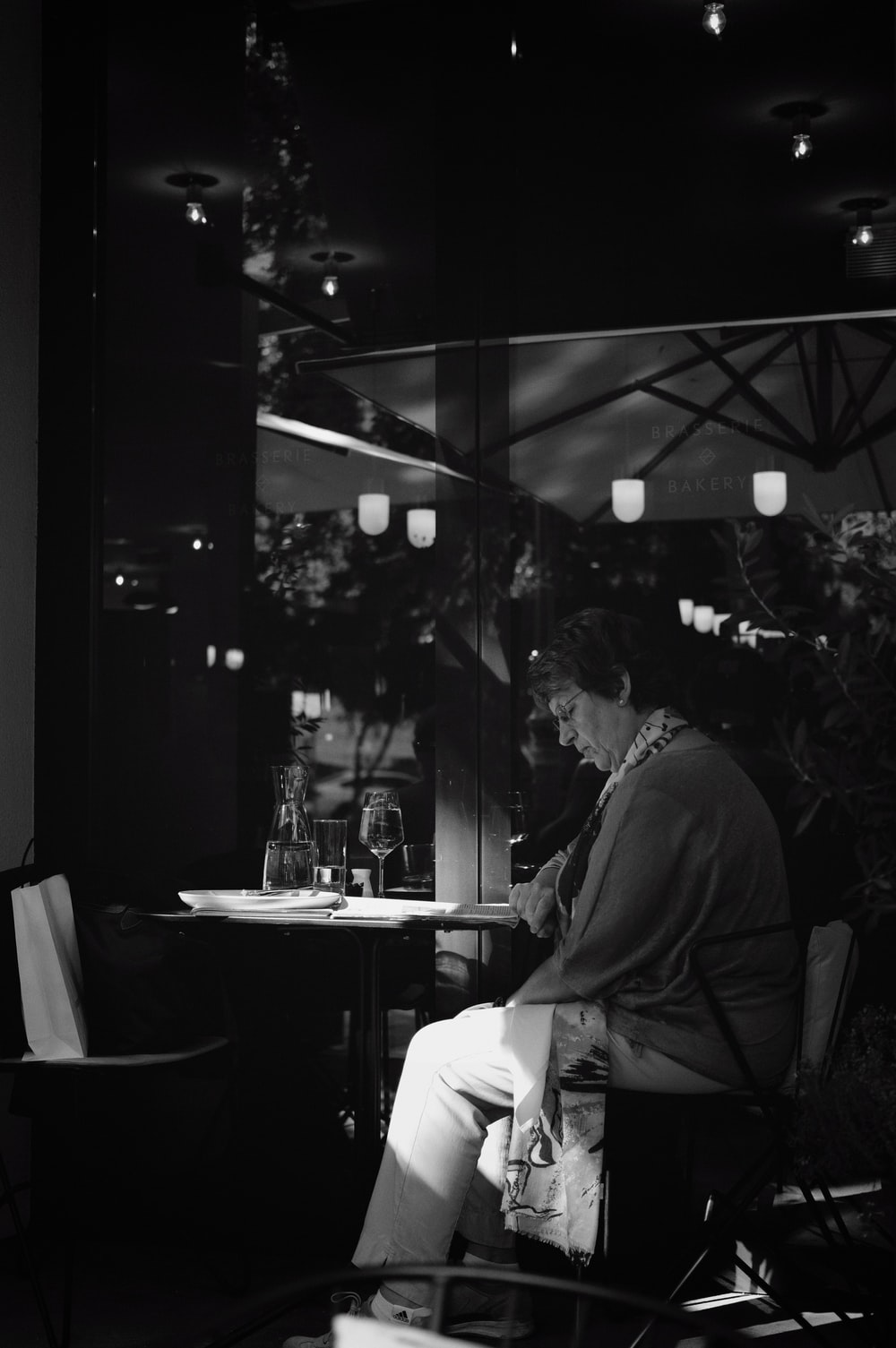 man sitting on chair with table