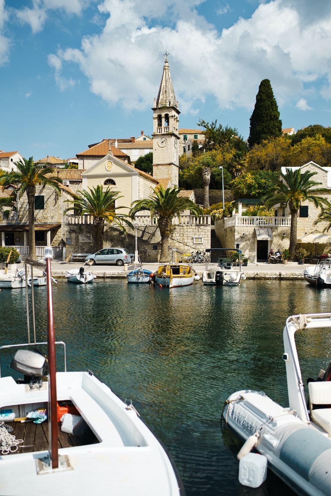 Old town in Croatia in Brač, sea, port, boats, palms