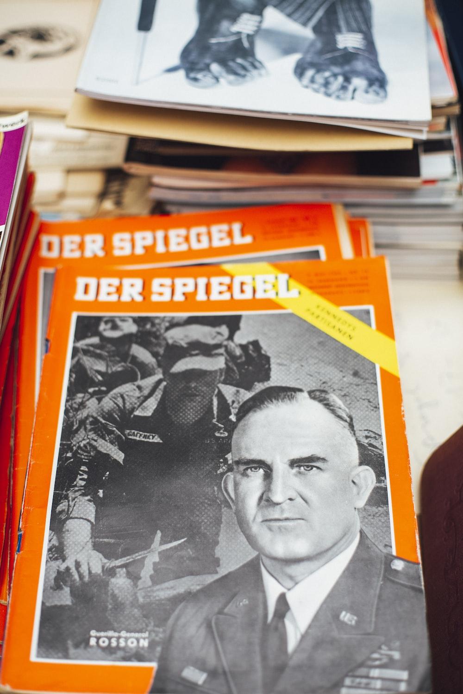 two Der Spiegel books on white surface