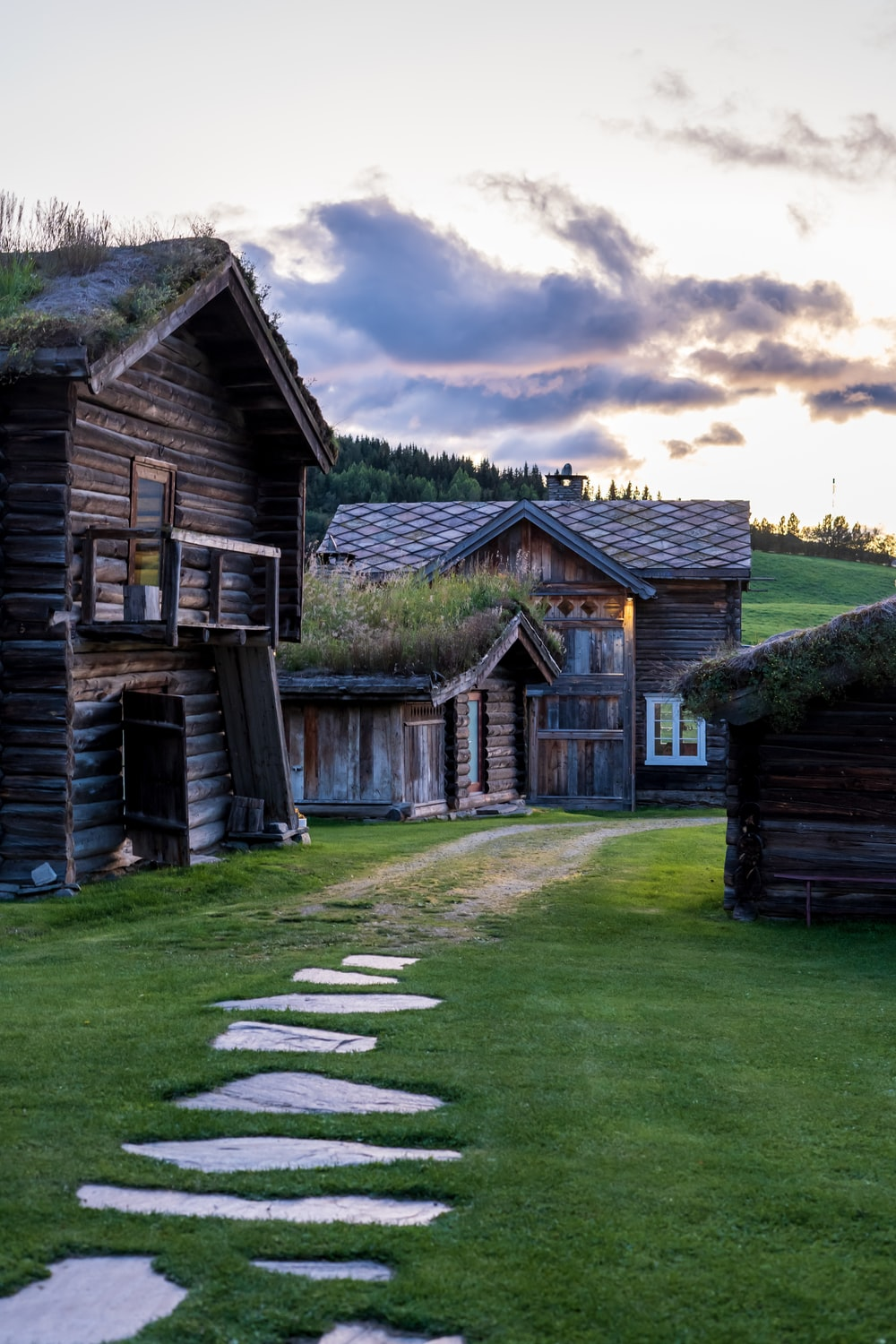 brown wooden house and grass field