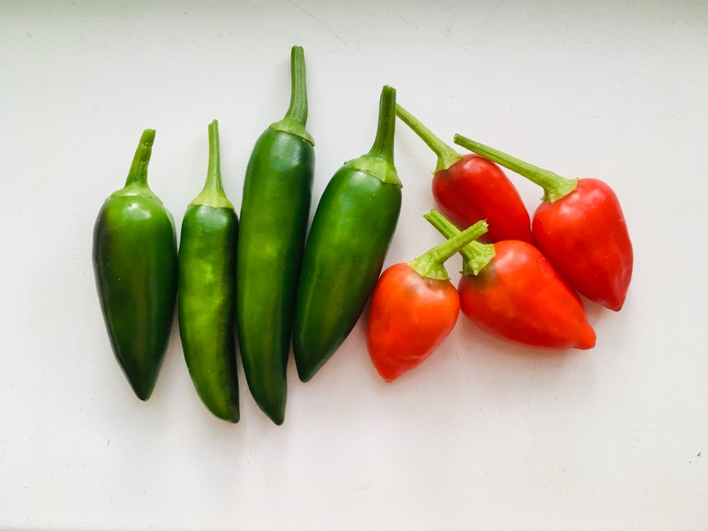 pile of two types of red and green chilis