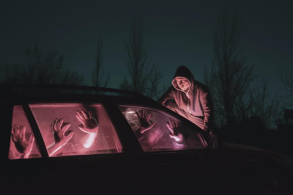 man in black hoodie during nighttime