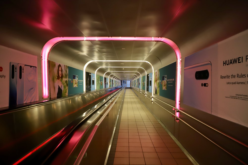 tunnel with advertisement posters and lights