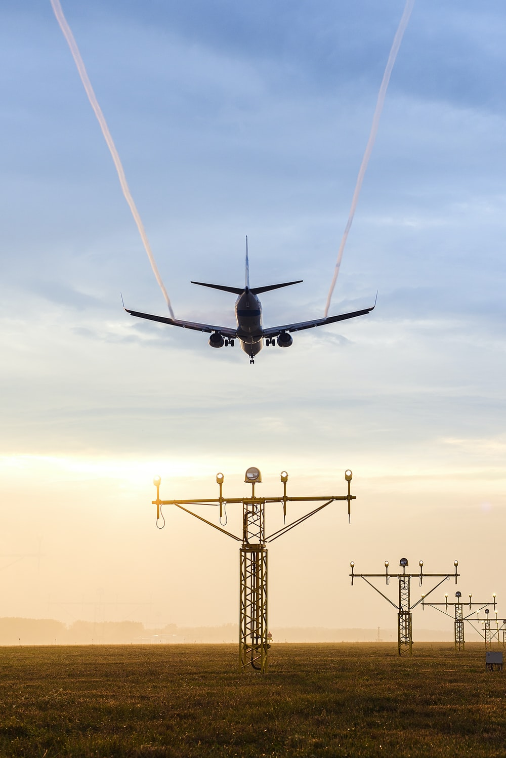 plane over electric tower