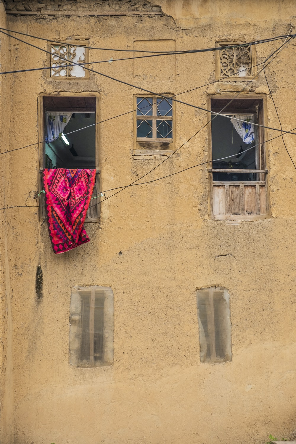 red cloth hanging on window