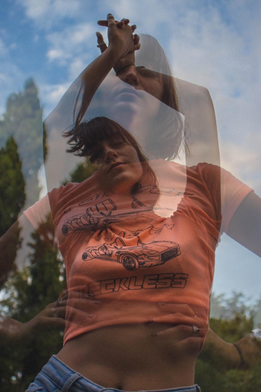 woman wearing orange crop top