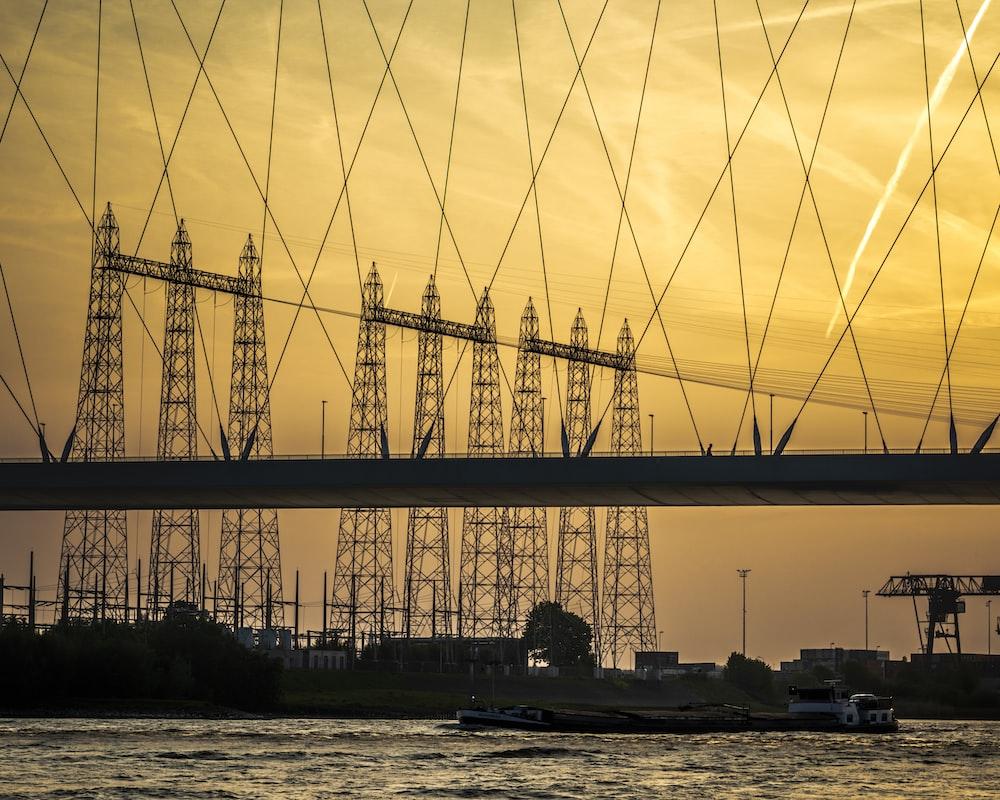 silhouette of bridge during daytime