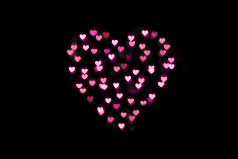 pink hearts lights on black background