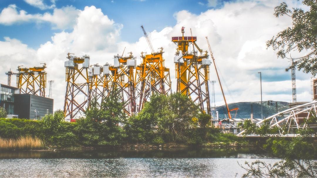 The ship-building crane Samson aiding in erecting derricks.