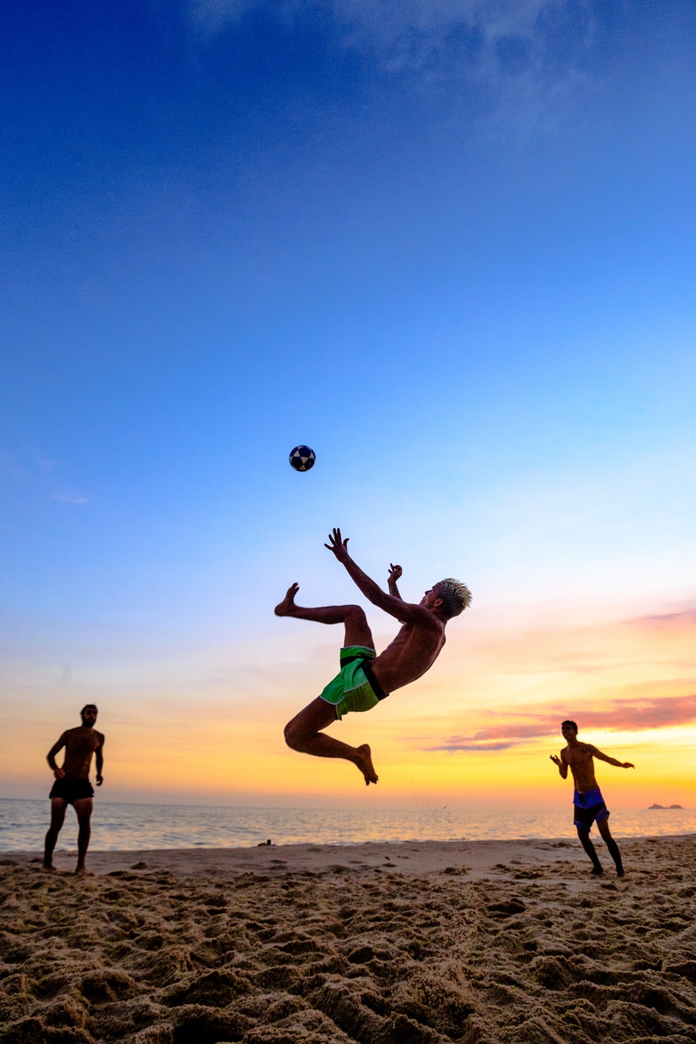 people playing at the beach during day