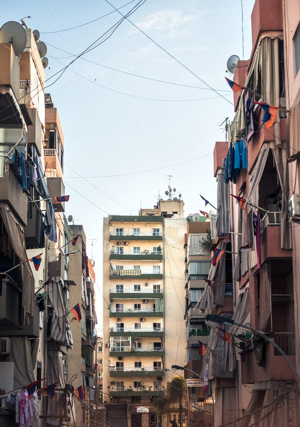 narrow street between concrete buildings