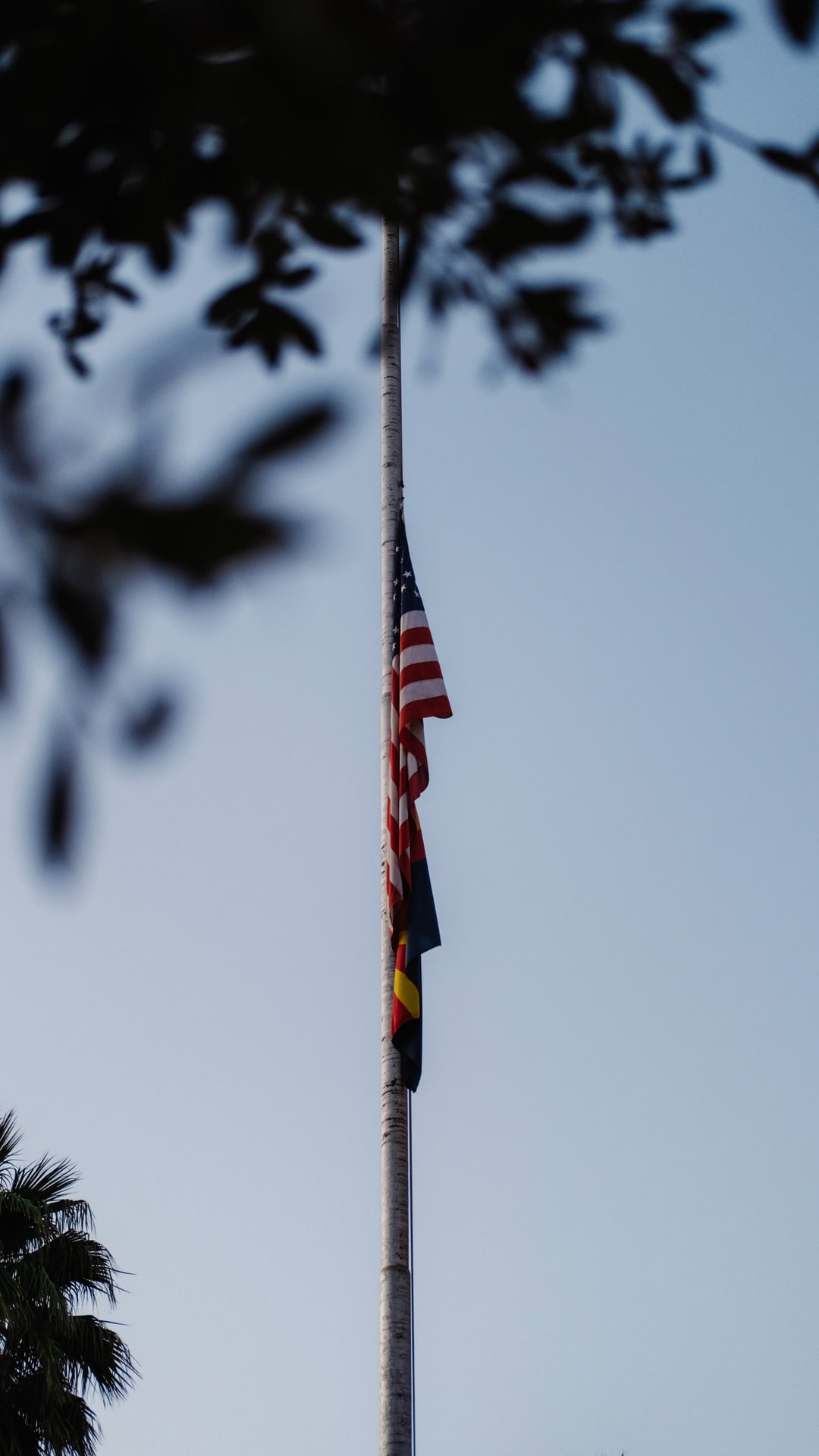 Never forget. A flag at half-mast.