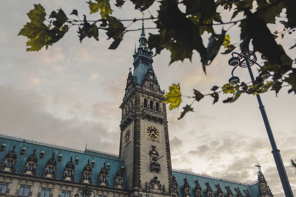 architectural photography of gray and blue clock tower