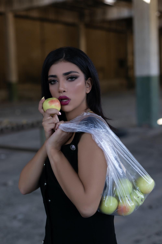 woman holding green apple fruit