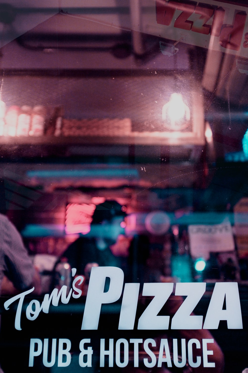 people with Tom's Pizza text