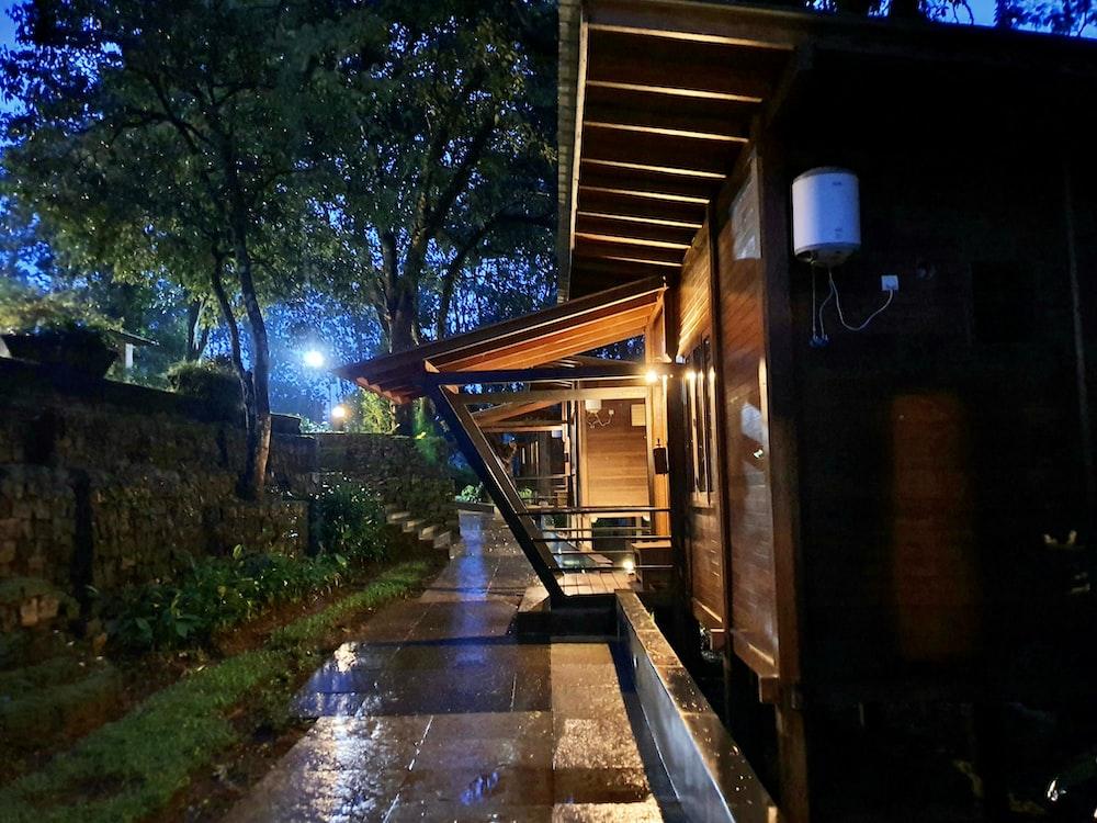 empty hallway beside lighted cabin