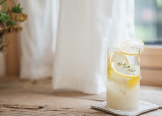 clear drinking glass with water and lemon