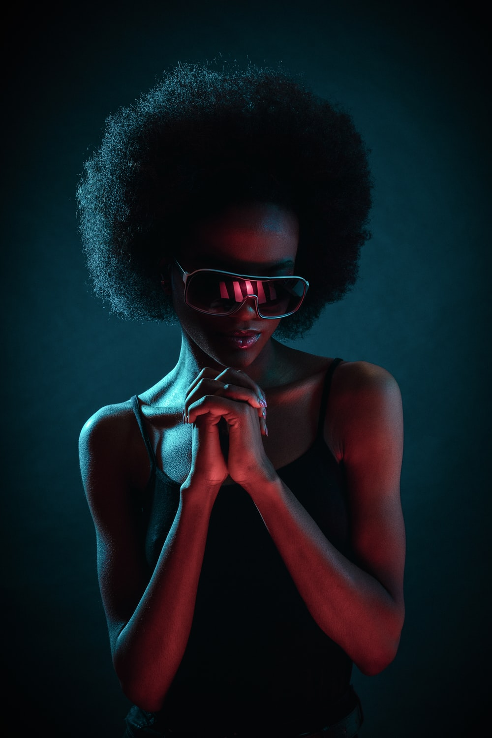 woman wearing black sunglasses and black camisole