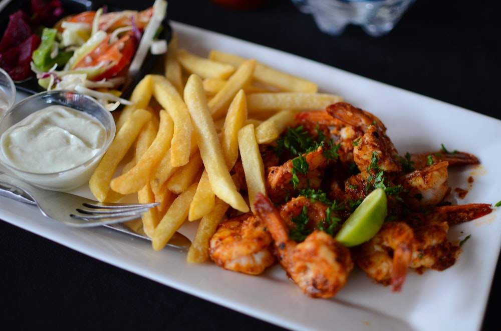 food photography of cooked shrimp and French fries