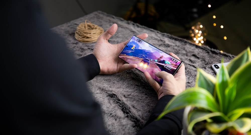 person playing with smartphone
