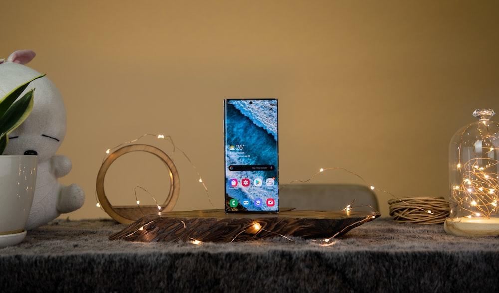 black smartphone on table