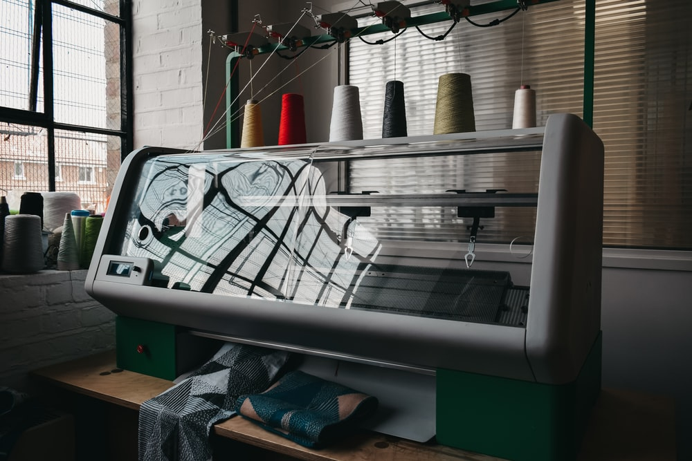 gray and green industrial weaving machine