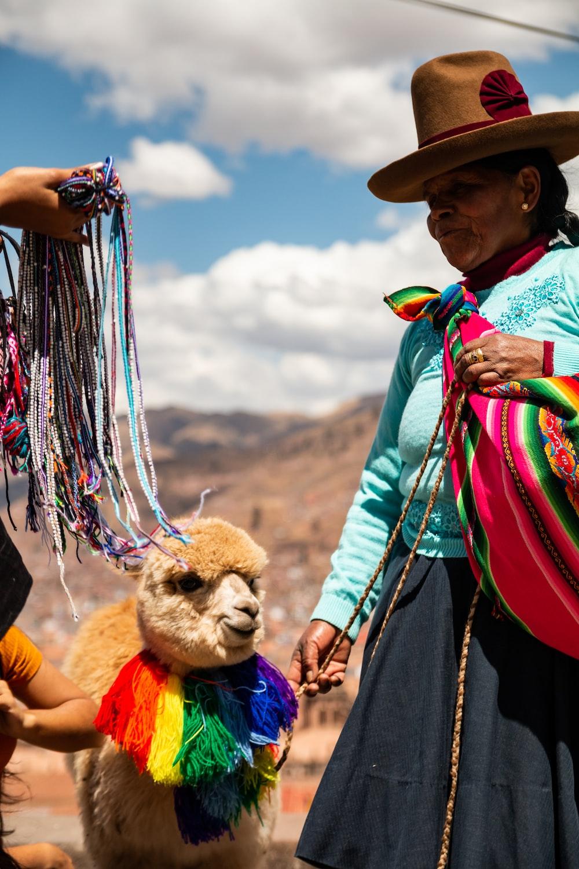 woman standing near mascot
