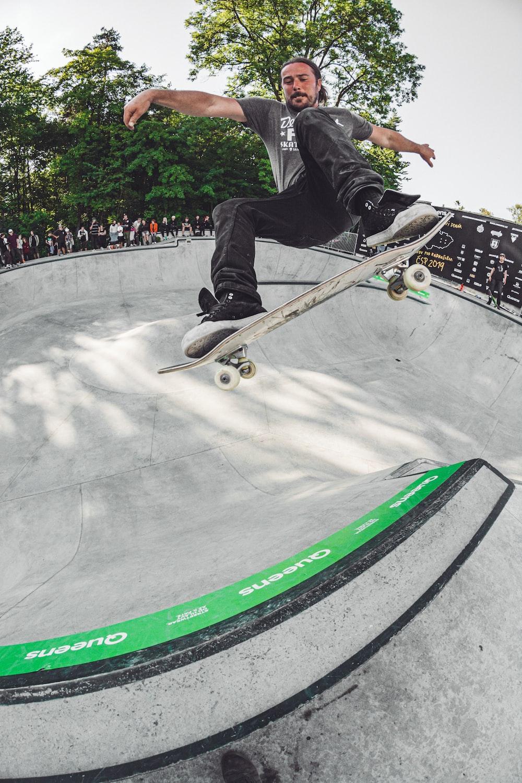man skateboarding during daytime