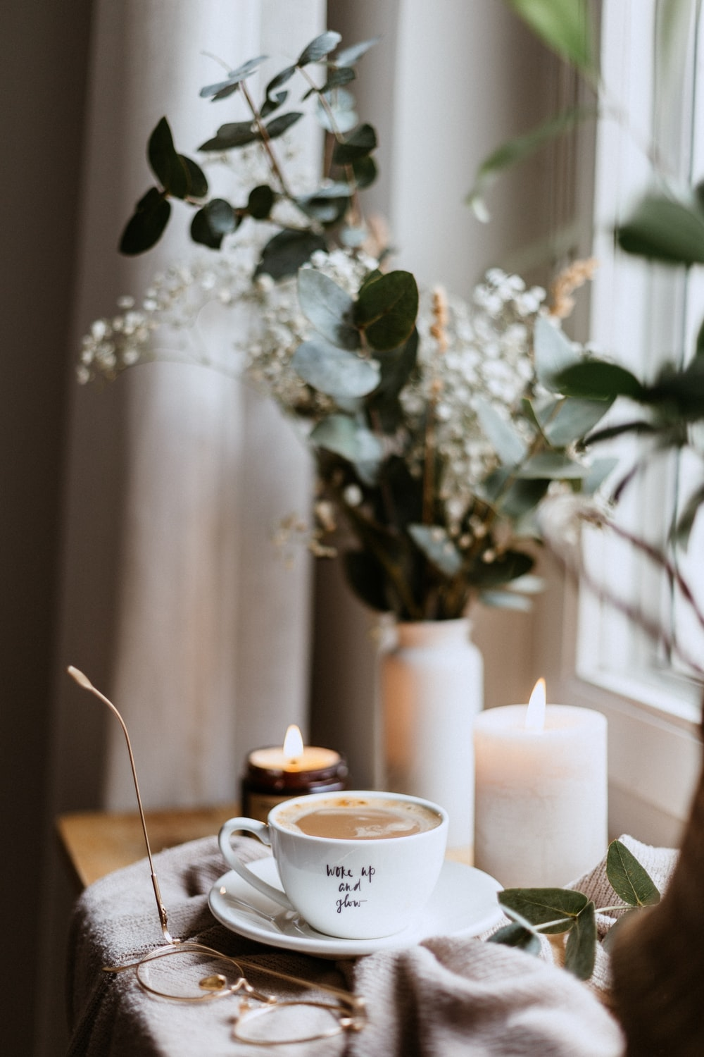 white ceramic cup and saucer inside room