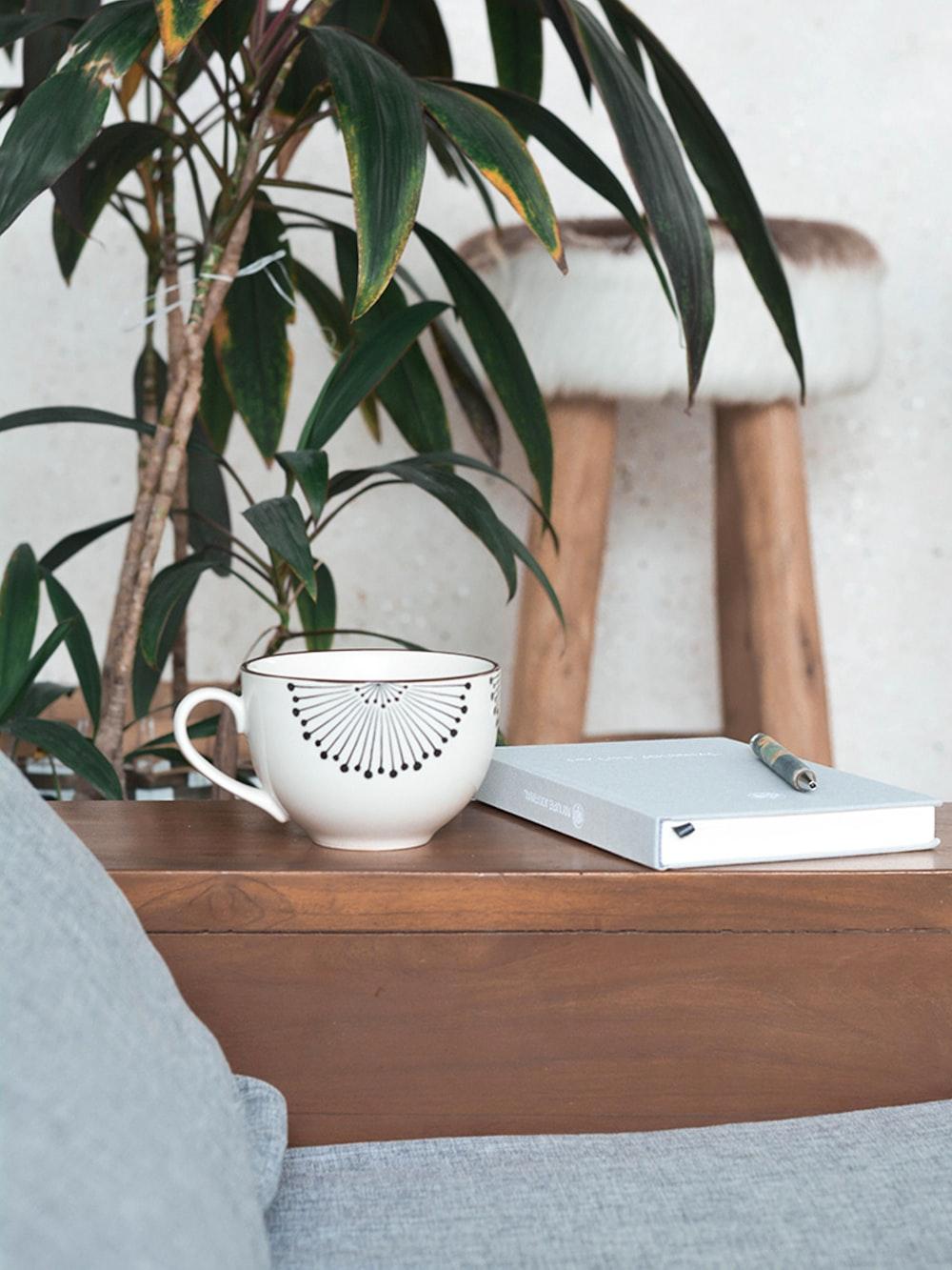 white mug on brown table